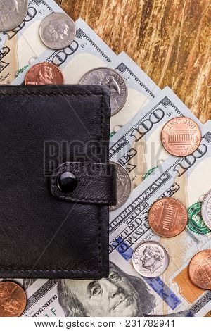 Black Leather Wallet Above To Banknotes And Coins Us. Closed. Finance Background. Concept Of Saving