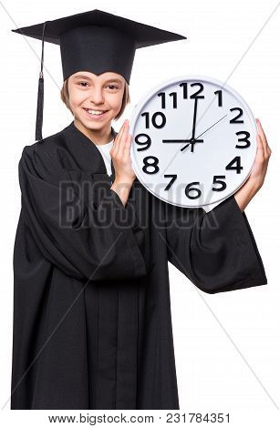 Portrait Of A Graduate Girl Student In A Black Graduation Gown With Hat, Holding Big Clock - Isolate
