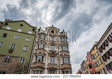 Innsbruck, Austria - August 9, 2017: Low Angle View Of Old Buildings In Christkindlmarkt Near Golden