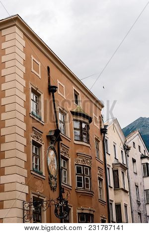 Innsbruck, Austria - August 9, 2017: Low Angle View Of Old Buildings In Old Town Of Innsbruck A Clou