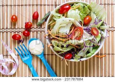 Dietary Salad With Fresh Vegetables (tomato, Cucumber, Chinese Cabbage, Red Onion And Cranberries).