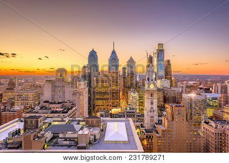 Philadelphia, Pennsylvania, USA skyline over the Center City business district at dusk.