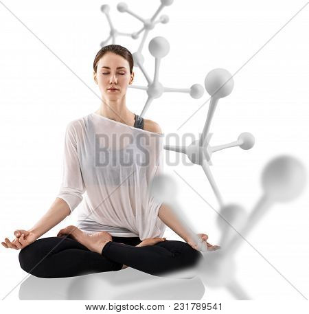 Young Woman Practicing Yoga, Sitting In A Lotus Position Near Big Molecule Chain. Isolated Over Whit