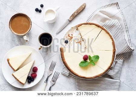 Classic New York Cheesecake And Coffee On White Concrete Background, Top View. Coffee And Cheesecake