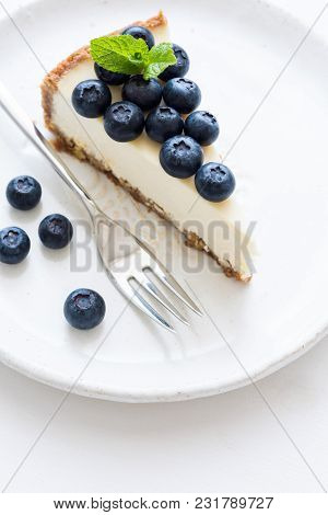 New York Cheesecake With Fresh Blueberries And Mint On White Background, Selective Focus. Blueberry