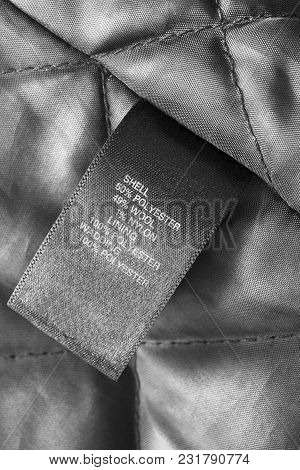 Composition Clothes Label On Black Textile Quilted Background
