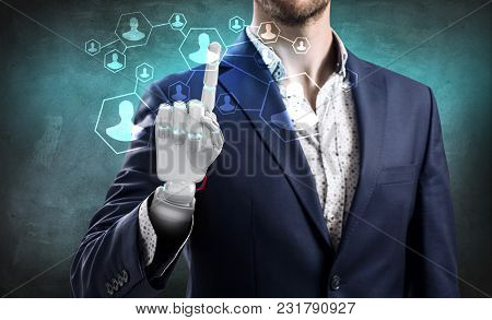 Businessman With Robot Hand Touches Icons Over Gray Wall Background.