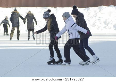 Two Teen Girlfriends Learning To Skate And Having Fun, Youth Pastime And Rest
