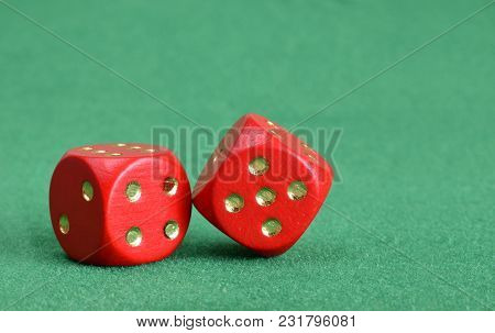 Red Dice With Golgen Points Closed Up On Green