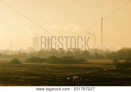 Nature Landscape With Factory And Pipes Of Which Goes Smoke In The Background, Concept Of Environmen