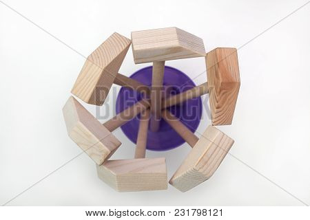 Wooden Hammers In A Glass On A White Background
