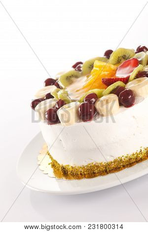A Close Up Shot Of Fruitcake On A White Background.