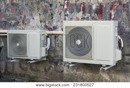 Airconditioner On The  Wall Of The House