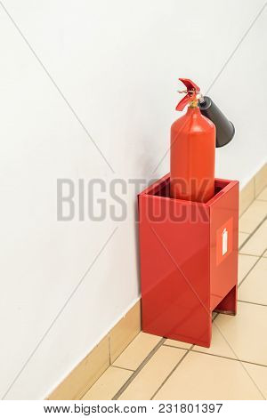 Fire Extinguisher Near The Wall Indoors Close Up