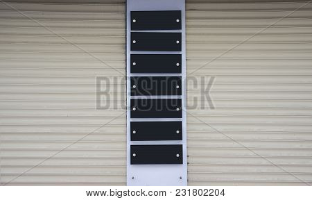 Blank Black  Company Plates Mounted On The Wall