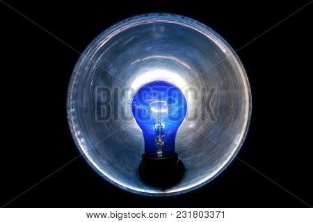 Burning Blue Lamp With A Reflector On A Black Background