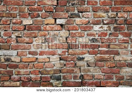 Old Brick Wall With A Crack Close-up