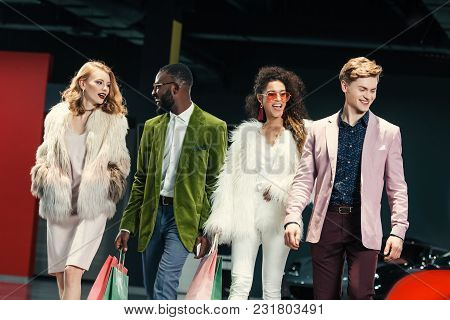 Group Of Stylish Young Multicultural Shoppers Walking By Auto Showroom