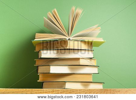 Open Book On Stack Of Books. Education Background. Back To School.