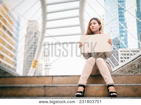 Unemployment. Young Businesswoman With Sign Looking For A Job.