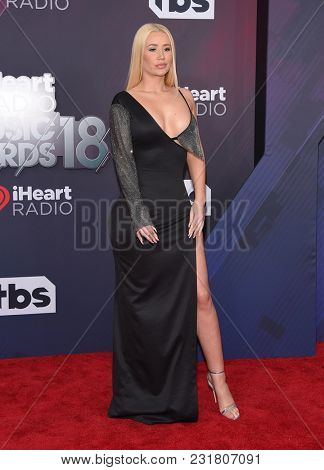 LOS ANGELES - MAR 11:  Iggy Azalea arrives for the 2018 iHeartRadio Music Awards on March 11, 2018 in Los Angeles, CA