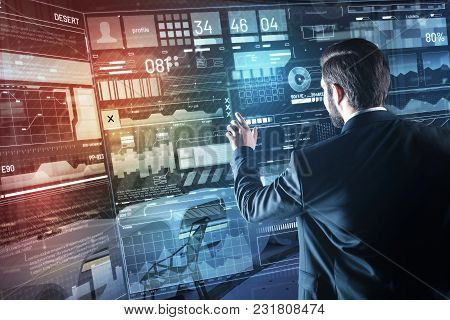 New Information. Attentive Professional Young Programmer Carefully Studying New Personal Information