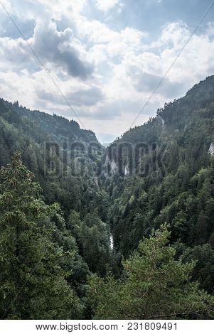 Wild Kvacianska Dolina Valley With Deep Forest, Limestone Rocks And Creek In Chocske Vrchy Mountains