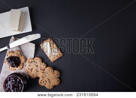 Biscuits With Butter And Berry Jam On A Dark Background