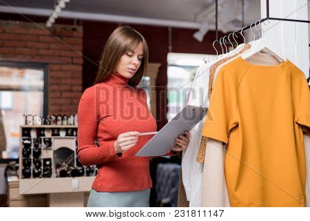 Young girl at work in the store