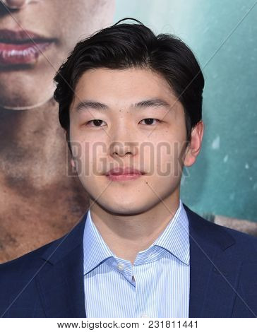 LOS ANGELES - MAR 12:  Alex Shibutani arrives for the 'Tomb Raider' US Premiere on March 12, 2018 in Hollywood, CA