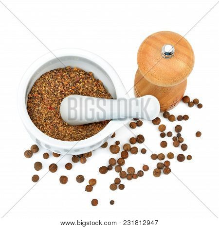 Kitchen Equipment For Grinding Spices Isolated On A White Background. Bitter Pepper. Flat Lay,top Vi