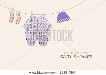 Baby Boy Clothing On Clothesline On Yellow Background