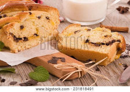 Brioche With Chocolate Chips On Wooden Table.