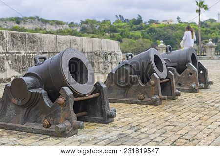 The Gun On The Gun Carriage Is Installed In The Old Fortress, A Symbol Of Military Power And Protect