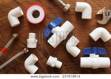 Plumbing Tools And Equipmentn On Wooden Background.