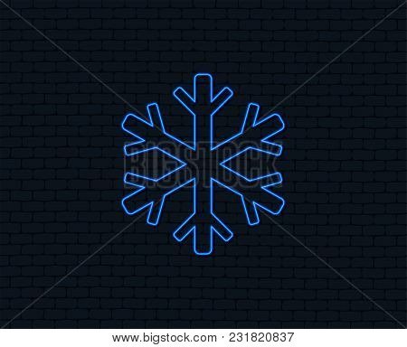 Neon Light. Snowflake Sign Icon. Air Conditioning Symbol. Glowing Graphic Design. Brick Wall. Vector