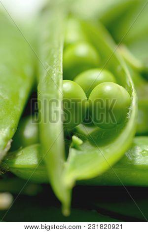 Beautiful Closeup Of Green Fresh Peas And Pea Pods. Healthy Food. Macro Shooting. Young Green Peas I