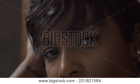 Closeup Mixed Race Woman Portrait During A Rest In Fitness Workout Looking At Camera And Deep Breath