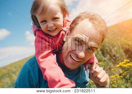 Happy Father And His Cute Daughter On The Shoulders, Family Time Outdoors, Intentional Sun Glare