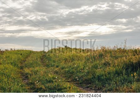 Road Lane And Deep Gray Sky With Clouds. Nature Design.