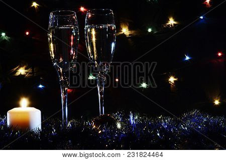High Glasses For Champagne. Good New Year Spirit. Candles And Ch