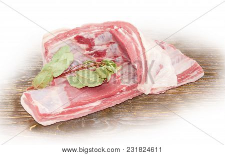 Two Strips Of The Pork From Side Part With Belly And Spare Ribs And Branch With Dry Laurel Leaves On