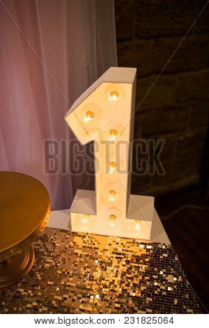 Wooden Electric Light Up Lamp Alphabet In Hard Font. Number 1. Wooden Number 1 With Bulbs. First Bir