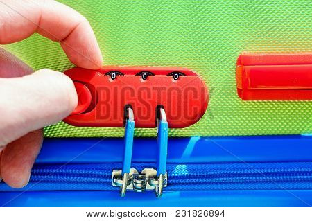 Person Opens A Locking Mechanism On The Suitcase, Access To Personal Belongings During The Trip. The