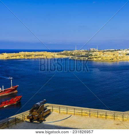 Tank Ship Designed For Transporting Liquefied Natural Fuels In The Port Of Malta. Old Cannon Guardin