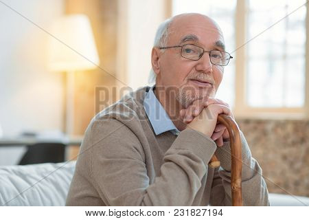 Join To Me. Meditative Attractive Senior Man Leaning On Cane While Wearing Glasses And Looking At Ca