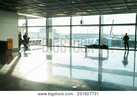 Frankfurt Am Main, Germany - October 11, 2015: People Wait For For Flight In Airport At Big Window G