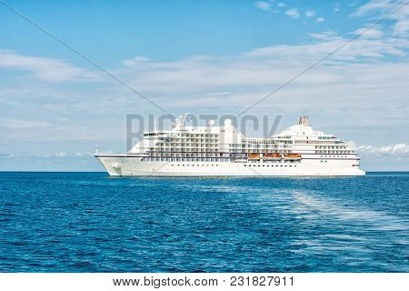 Ship In Sea In Great Stirrup Cay, Bahamas. Ocean Liner On Blue Seascape. Water Transport, Vessel. Ad
