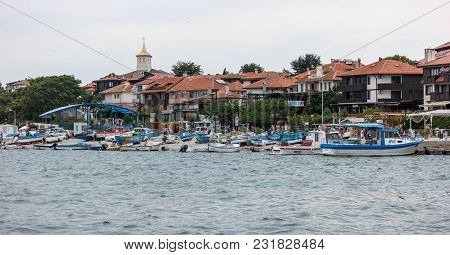 Nesebar, Bulgaria - August 21, 2017: View At The Old Town Of Nesebar And Boats In The Seaport. Neseb