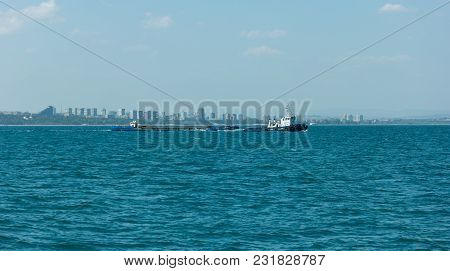 Burgas, Bulgaria - August 20, 2017: Tug And Barge Floating In The Burgas Bay Of The Black Sea. Bulga